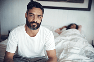 man-in-bedroom-with-performance-anxiety